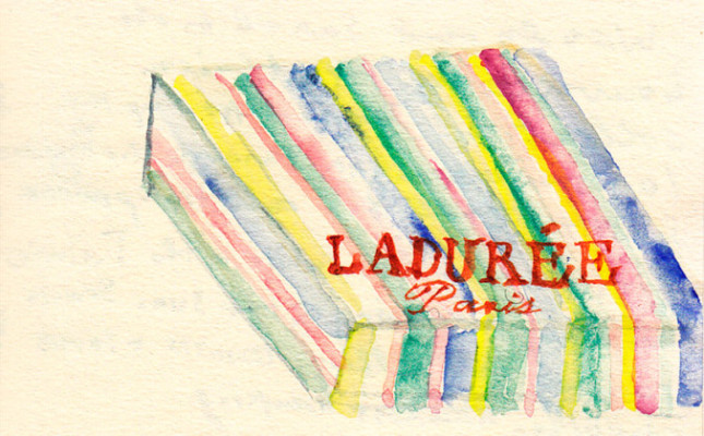 """In Ladurée a polite young woman slips her hand into a surgeon's glove, takes colorful <em>macarons</em> from the rows on display, and nestles them one by one into a tissue-lined box. 'So <em>Franche</em>,' Wendy says."""